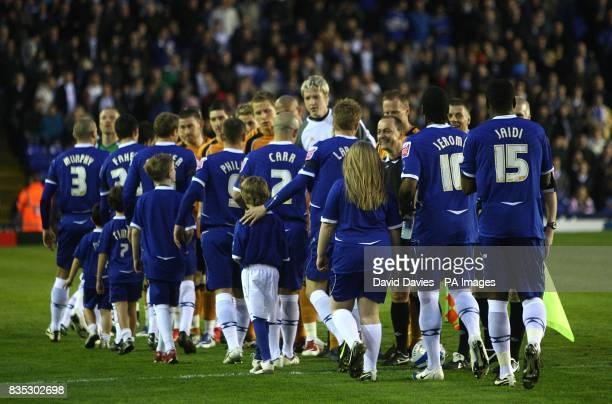 Birmingham City players shake hands with Wolverhampton Wanderers' players prior to kick off