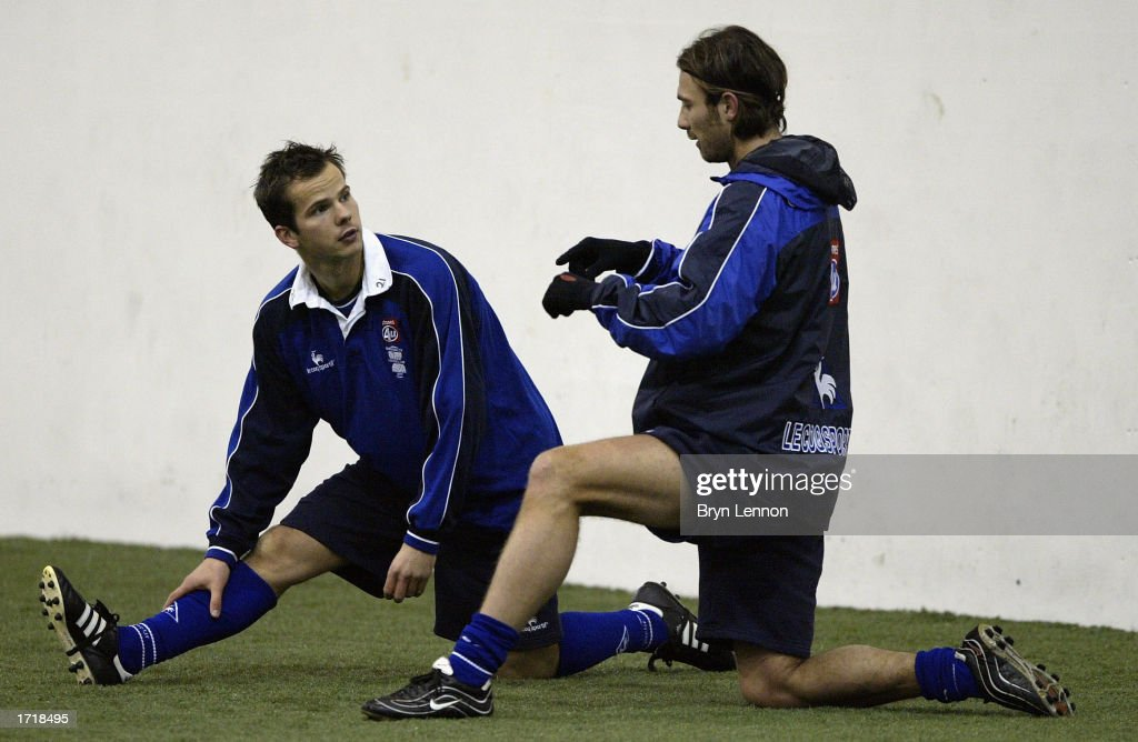 Birmingham City sigining Steve Clemence (L) chats to Christophe Dugarry during training Kings Norton in Birmingham, England on January 10, 2003.