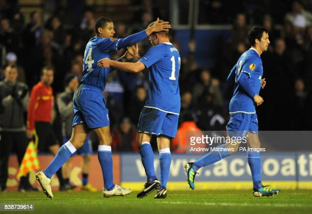 Birmingham City's Adam Rooney is congratulated by team mate Curtis Davies after he score the opening goal of the game during the UEFA Europa League...