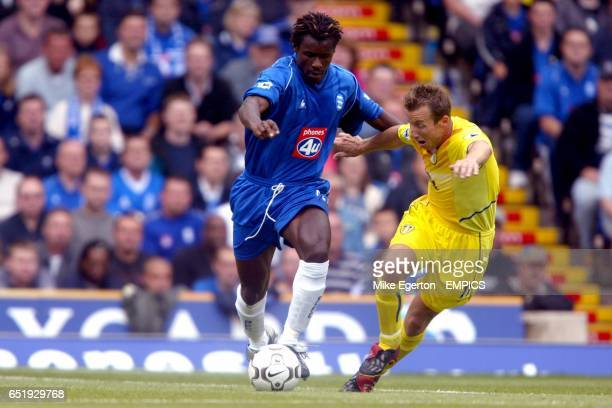 Birmingham City's Aliou Cisse is put under pressure by Leeds United's Lee Bowyer