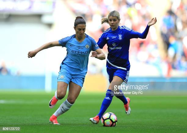 Birmingham City's Andrine Hegerberg and Manchester City's Carli Lloyd battle for the ball