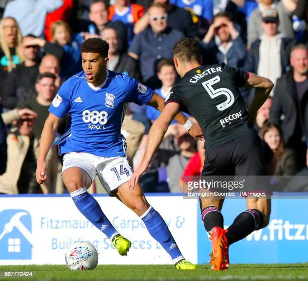 Birmingham City's Che Adams and Aston Villa's James Chester battle for the ball during the Sky Bet Championship match at St Andrew's Birmingham