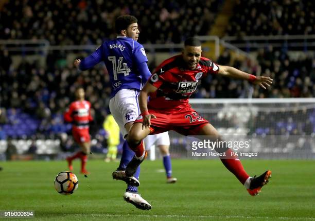 Birmingham City's Che Adams and Huddersfield Town's Mathias Jorgensen during the Emirates FA Cup fourth round replay match at St Andrews Birmingham