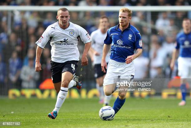 Birmingham City's Chris Burke and Leicester City's Daniel Drinkwater battle for the ball