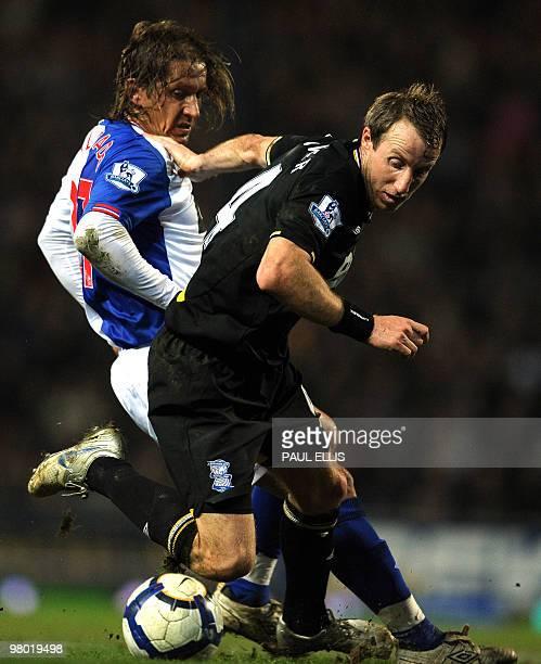 Birmingham City's English midfielder Lee Bowyer is challenged by Blackburn Rovers' Spanish defender Míchel Salgado during their English Premier...