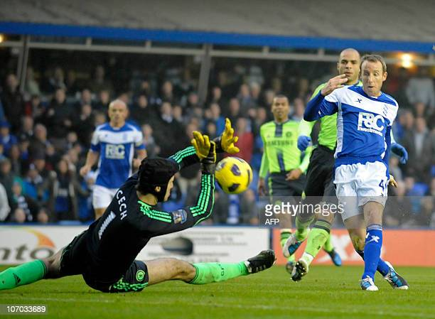 Birmingham City's English midfielder Lee Bowyer scores the opening goal past Chelsea's Czech goalkeeper Peter Cech during the English Premier League...