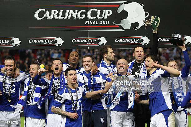 Birmingham City's football team poses with the trophy at the end of the Carling Cup final football match between Arsenal and Birmingham at the...