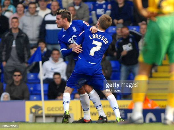 Birmingham City's Franck Queudrue is restrained by team mate Sebastian Larsson durng an altercation with Norwich City's Alan Lee