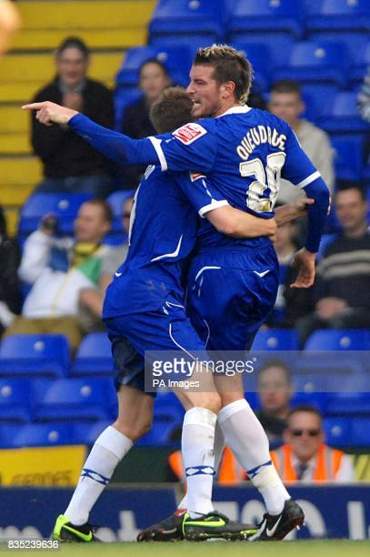 Birmingham City's Franck Queudrue is restrained by team mate Sebastian Larsson during an altercation with Norwich City's Alan Lee