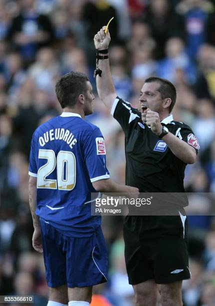 Birmingham City's Franck Queudrue is shown a yellow card by referee Phil Dowd for unsporting behaviour