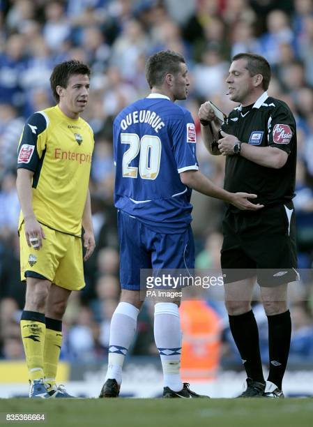 Birmingham City's Franck Queudrue is shown a yellow card by referee Phil Dowd for unsporting behaviour Preston North End's Sean StLedger looks on