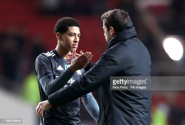 Birmingham City's Jude Bellingham greets manager Pep Clotet after the final whistle during the Sky Bet Championship match at Ashton Gate Bristol
