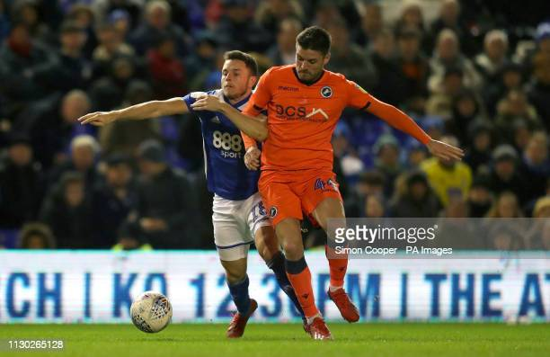 Birmingham City's Kerim Mrabti Millwall's Ben Marshall battle for the ball and during the Sky Bet Championship match at St Andrew's Trillion Trophy...