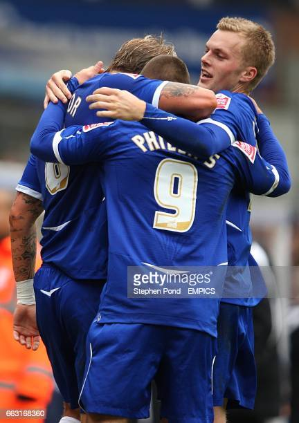 Birmingham City's Kevin Phillips celebrates after scoring the opening goal of the game, with team mates Sebastian Larsson and Garry O'Connor.