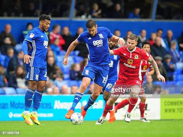 Birmingham City's Lukas Jutkiewicz under pressure from Blackburn Rovers' Danny Guthrieduring the Sky Bet Championship match between Birmingham City...