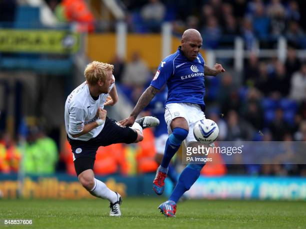Birmingham City's Marlon King and Leicester City's Zak Whitbread battle for possession of the ball during the npower Football League match at St...