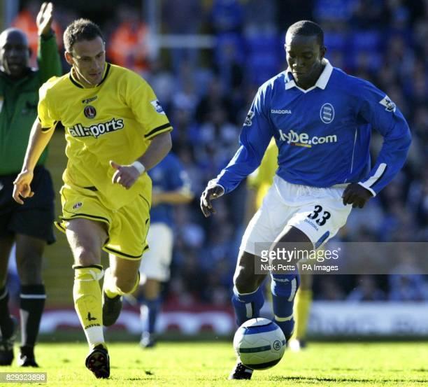Birmingham City's new signing Dwight Yorke scorer of the equalising goal runs away from Charlton Athletic's Radostin Kishishev during Birmingham...