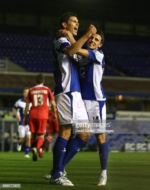 Birmingham City's Nikola Zigic celebrates scoring his sides second goal of the game with teammate Matt Derbyshire