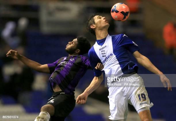 Birmingham City's Nikola Zigic heads the ball away from Bristol Rovers' Ellis Harrison