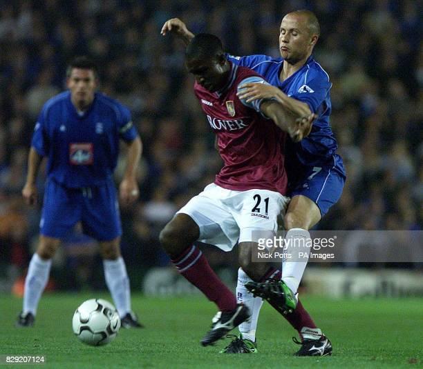 Birmingham City's Paul Devlin challenges Aston Villa's defender JLoyd Samuel during FA Barclaycard Premiership game at St Andrews Birmingham between...