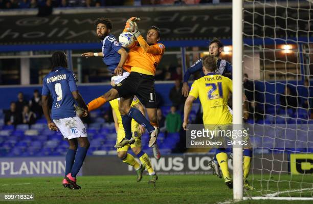 Birmingham City's Ryan Shotton and Leeds United's Marco Silvestri battle for the ball in the air