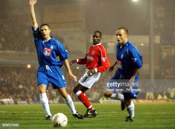 Birmingham City's Steve Vickers and Paul Devlin appeal for a goal kick as Charlton Athletic's Chris Powell sees his shot go wide during their FA...