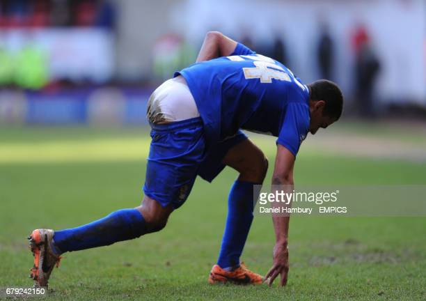 Birmingham City's Tom Adeyemi wipes the mud off his shorts after a fall at The Valley