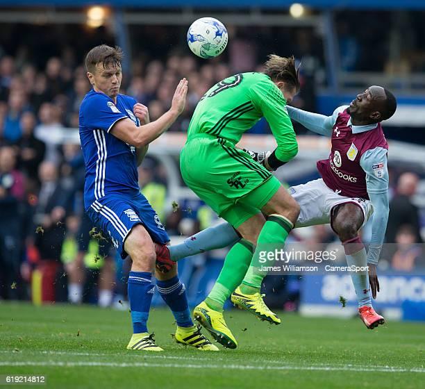 Birmingham City's Tomasz Kuszczak clashes with Aston Villa's Albert Adomah during the Sky Bet Championship match between Birmingham City and Aston...