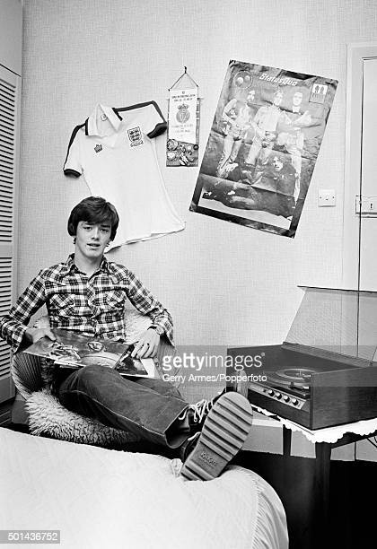 Birmingham City's young midfielder Kevin Dillon listening to some music in his bedroom at home in Birmingham 7th December 1977