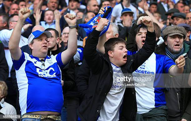 Birmingham fans celebrate during the Sky Bet Championship match between Bolton Wanderers and Birmingham City at the Reebok Stadium on May 3 2014 in...