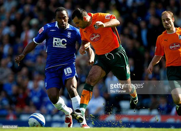 Birmingham forward Cameron Jerome battles for the ball with Chris Barker during the Coca Cola Championship match between Birmingham City and Plymouth...