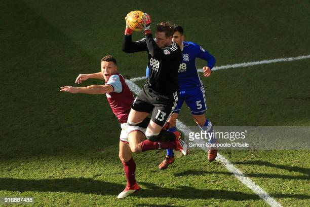 Birmingham goalkeeper David Stockdale catches the ball above James Chester of Villa during the Sky Bet Championship match between Aston Villa and...