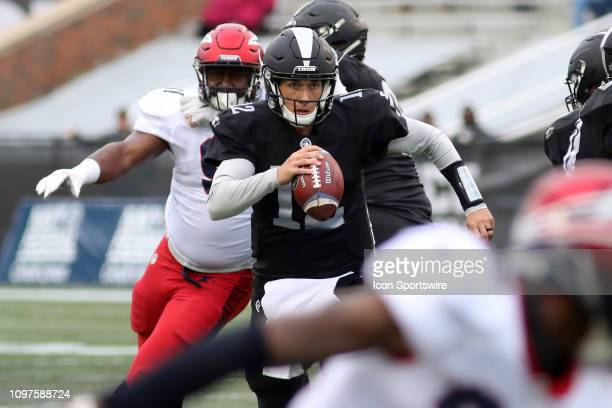 Birmingham Iron quarterback Luis Perez looks to run during the game between the Birmingham Iron and the Memphis Express at on February 10 2019 at...