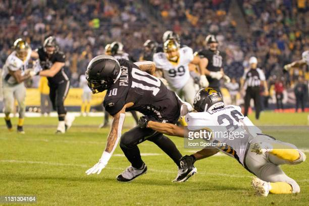 Birmingham Iron wide receiver Tobias Palmer avoids a tackle from San Diego Fleet corner back Xavier Coleman during the game between the Birmingham...