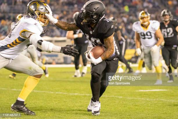 Birmingham Iron wide receiver Tobias Palmer stiff arms San Diego Fleet linebacker Travis Feeney during the game between the Birmingham Iron and the...
