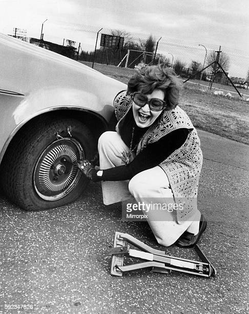 Birmingham Mail fashion editor Barbara Henderson has a go at changing a flat tyre 12th April 1976