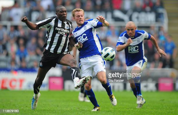 Birmingham player Sebastian Larsson battles with Shola Ameobi during the Barclays Premier League game between Newcastle United and Birmingham City at...