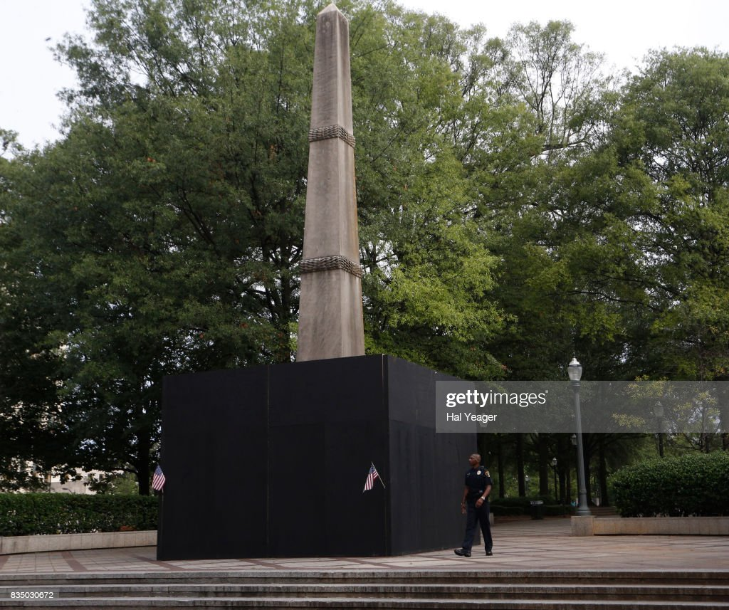 Birmingham police officer Glendon Archie guards the confederate monument in Linn Park after Birmingham Mayor William Bell ordered it covered August 18, 2017 in Birmingham, Alabama. Alabamas attorney general Steve Marshall sued the city of Birmingham and the mayor for partially covering the Confederate monument with a wooden box, citing it violated the Alabama Memorial Preservation Act.