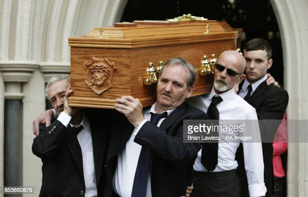 Birmingham Six member Paddy Hill and Guilford Four member Paddy Armstrong carry the coffin of Gerry Conlon who was wrongly convicted of the 1974 IRA...