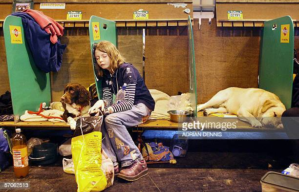Birmingham, UNITED KINGDOM: A young girl falls asleep beside her dog during the final day of Crufts 2006 dog show at the National Exhibition Centre...