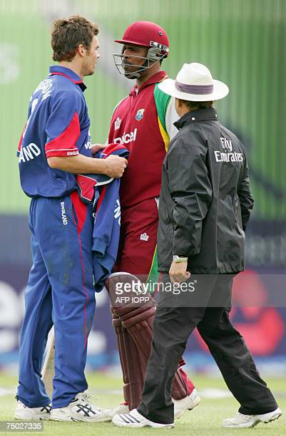 Cricket Umpire Brian Jerling moves in to separate West Indies batsman Runako Morton as he argues with England bowler James Anderson during the second...