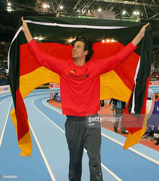 German Danny Ecker celebrates with his national flag after winning the Pole vault final 03 March 2007 during the 29th European Athletics Indoor...
