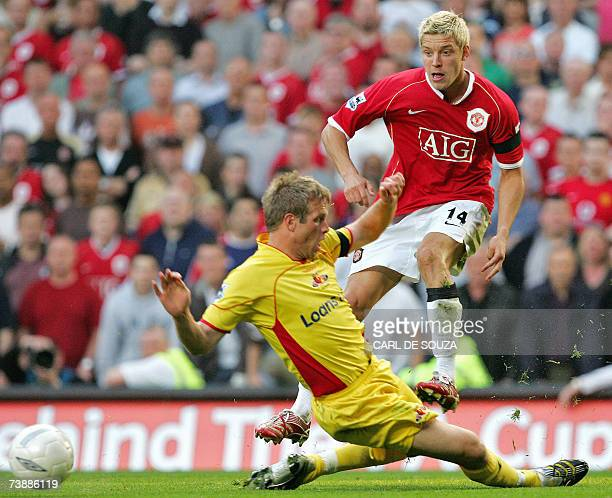 Manchester United's Alan Smith vies with Watford's Jay DeMerit during their FA Cup Semi Final football match at Aston Villa's Stadium Villa Park...