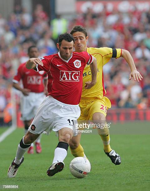 Birmingham, UNITED KINGDOM: Ryan Giggs of Manchester United and Tommy Smith of Watford battle for the ball during their FA Cup semi final football...