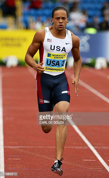 US Wallace Spearmon competes in the 200 metres event of the Norwich Union 2006 International Athletics competition at the Alexander stadium in...
