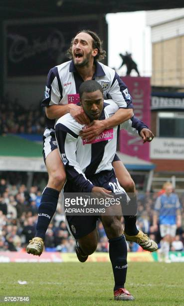 West Bromwich Albion player Jonathan Greening jumps onto Nathan Ellington after he scored the equalising goal against Birmingham City during the...