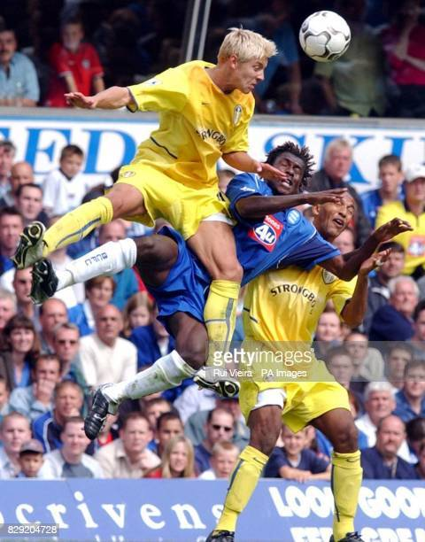 Birmingham's Aliou Cisse is put under pressure from Leeds' Alan Smith and Olivier Dacourt during the Barclaycard Premiership match between Birmingham...