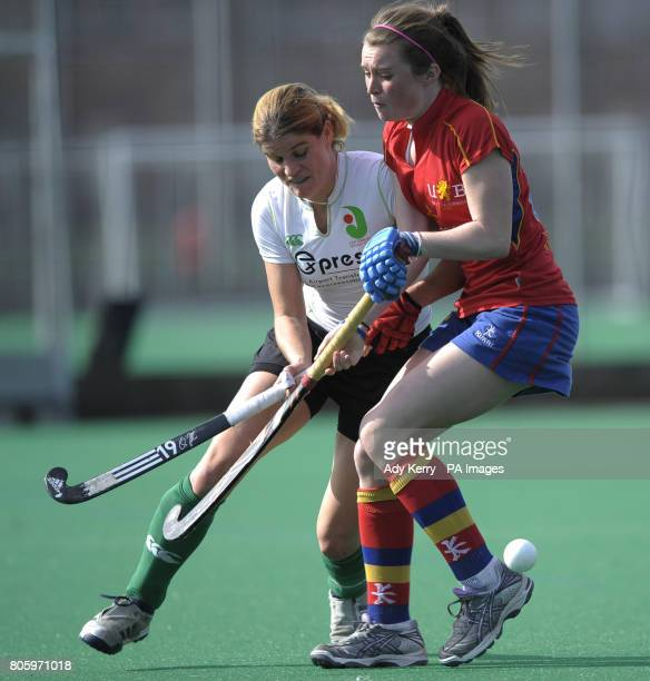 Birmingham's Emily Atkinson challenges with Canterbury's Jen Wilson during the England Hockey Premier League match at the University of Birmingham...