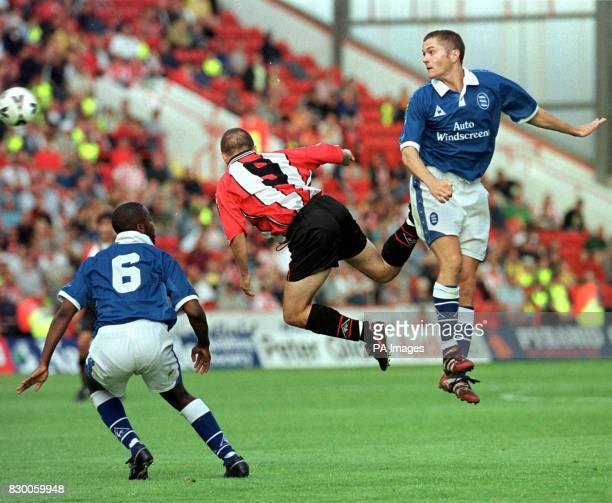 Birmingham's Gary Ablett in midair combat with Sheffield United' s Paul Devlin today Photo by Paul Barker/PA