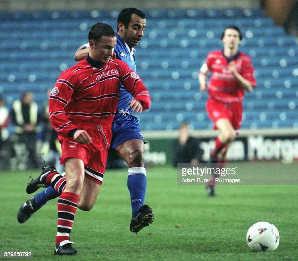 Birmingham's Paul Devlin fights off a challenge from Millwall's Dale Gordon during an Endsleigh League Division One match at The New Den